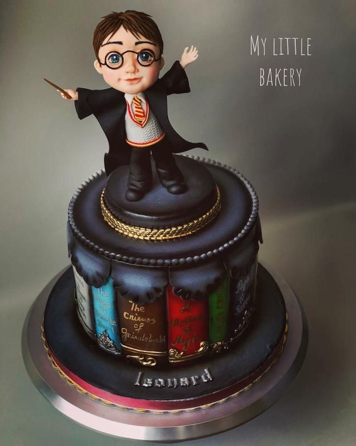 cake layer made up of books, 11th birthday cake, made with fondant, harry potter topper, placed on silver tray
