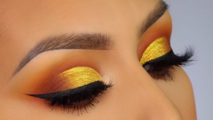 orange and yellow golden eyeshadow colors, how to put on eyeshadow, black cat eyeliner, thing brown eyebrows