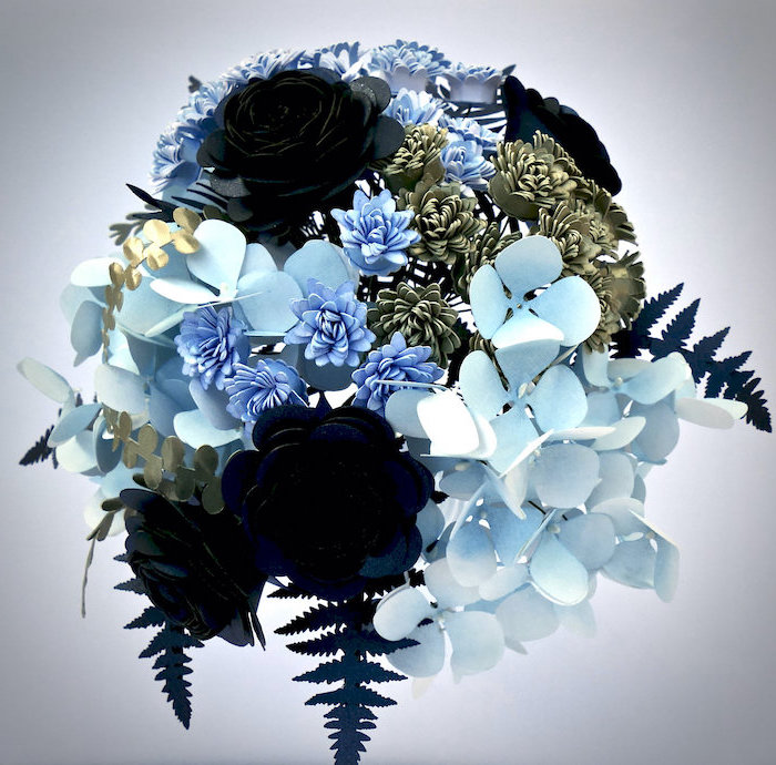 paper flowers in different shades of blue and gold, arranged in a bouquet, how to make flowers out of tissue paper
