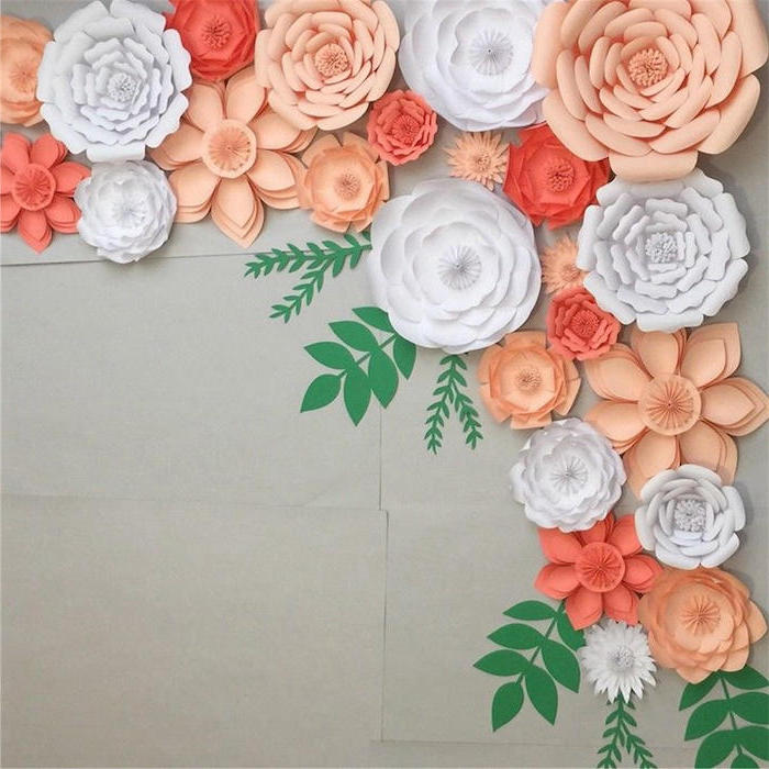 white and blush paper flowers, different shapes and sizes, how to make flowers out of tissue paper, arranged on grey wall