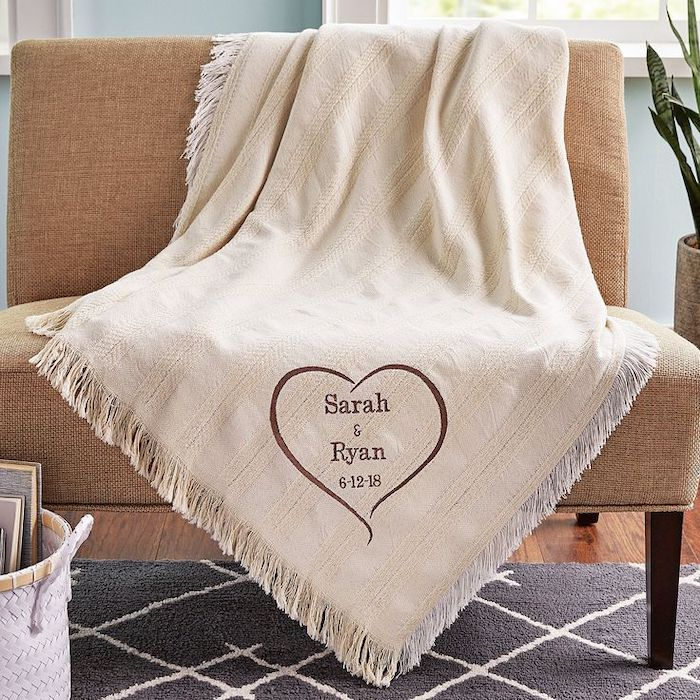 cute valentines day gifts for her, white blanket, thrown over a beige sofa, personalised with sarah and ryan written on it
