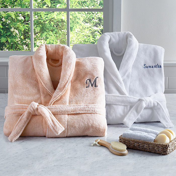 two cozy plush robes, romantic valentines gifts for her, personalised with name and initial, placed on marble surface
