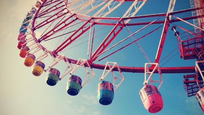 large ferris wheel, photographed from below, aesthetic phone backgrounds, blue sky with white clouds in the background