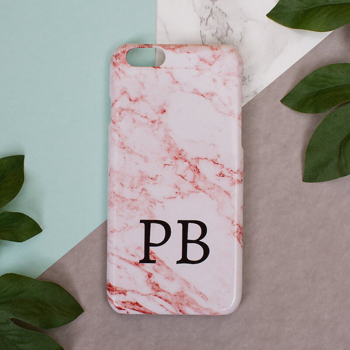 pink marble phone case, romantic valentines gifts for her, personalised with initials, placed on colorful surface