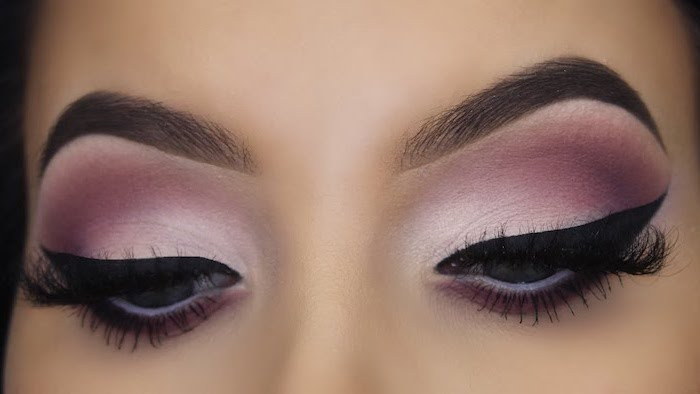 pink and purple white eyeshadow colors, black cat eyeliner, makeup for beginners, woman with thick dark eyebrows