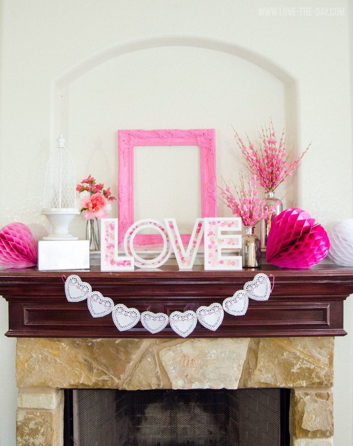 love wooden sign, pink wooden frame, hanging on white wall, valentine lights, hearts garland hanging over mantel