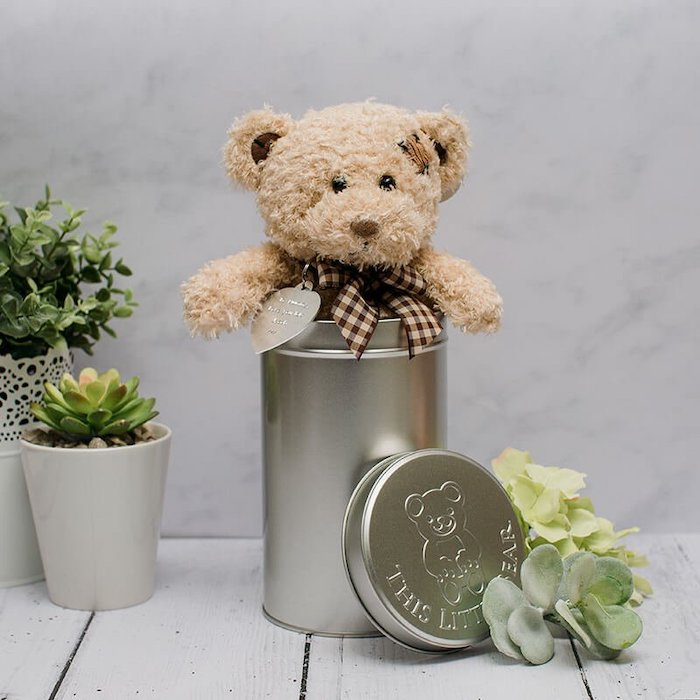 plush teddy bear, inside a metal can, placed on white wooden surface, romantic valentines gifts for her