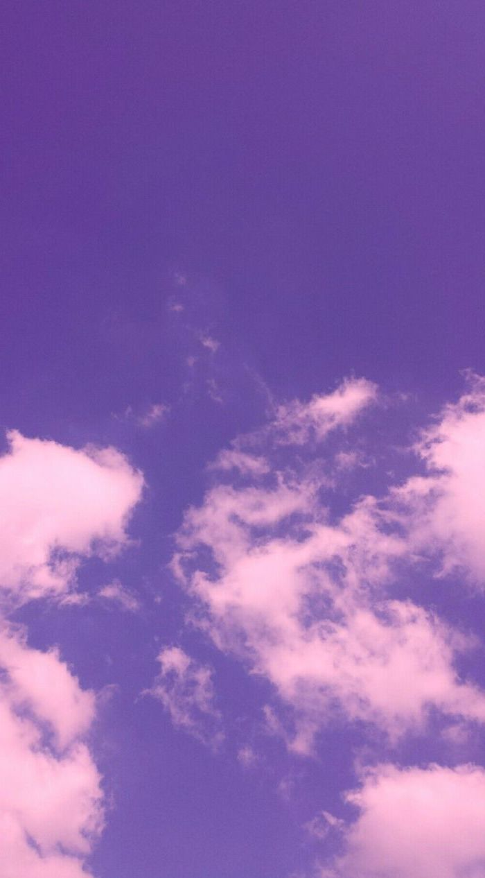 photograph of a sky, pink aesthetic background, purple sky with white clouds