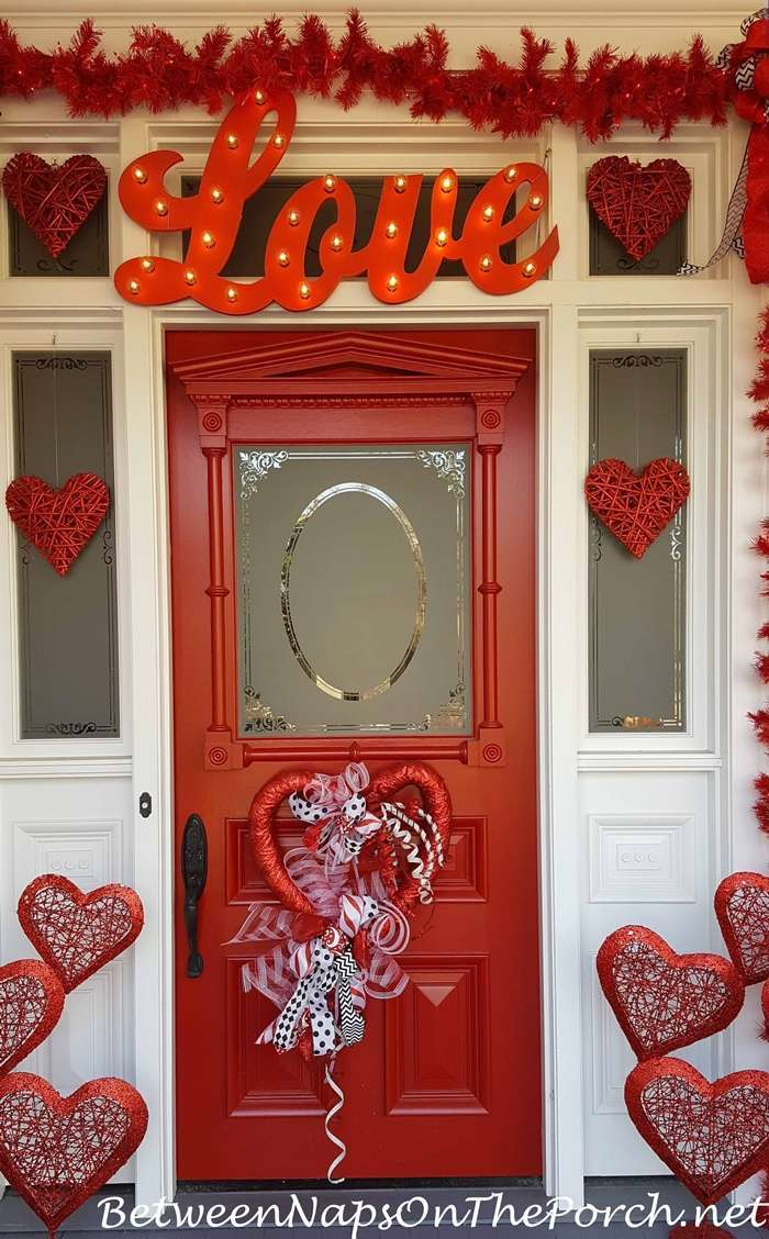 red love sign with lights, over red doors, valentine lights, hearts decoration in different sizes, red garland over the door