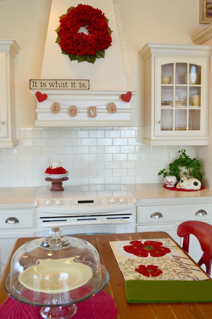 valentine's day home decor, red wreath hanging in the kitchen, love banner, it is what it is sign, kitchen in white