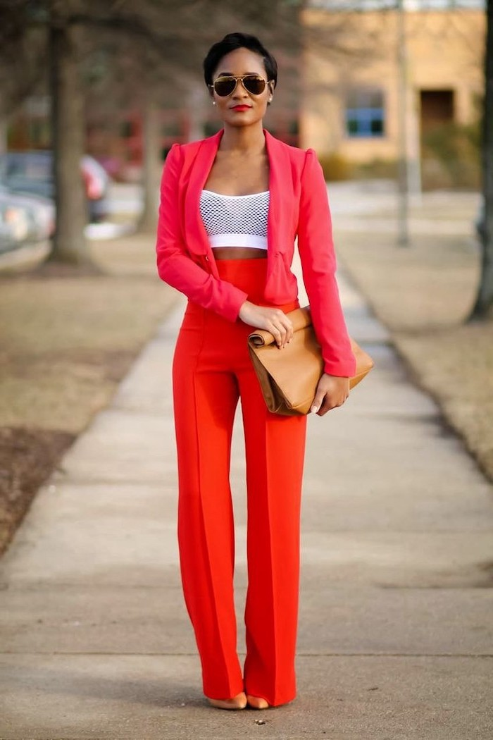 woman walking on the sidewalk, wearing red high waisted pants, red blazer and white crop top, valentine's day clothes