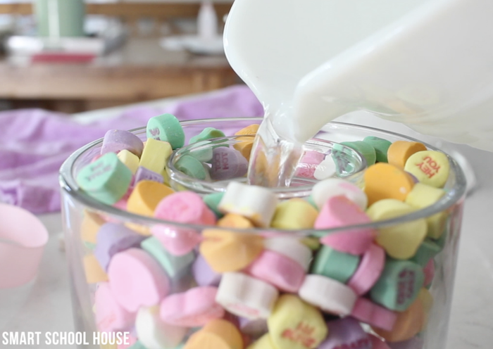 small vase filled with water, large vase filled with conversation hearts, valentines day gifts, step by step diy tutorial