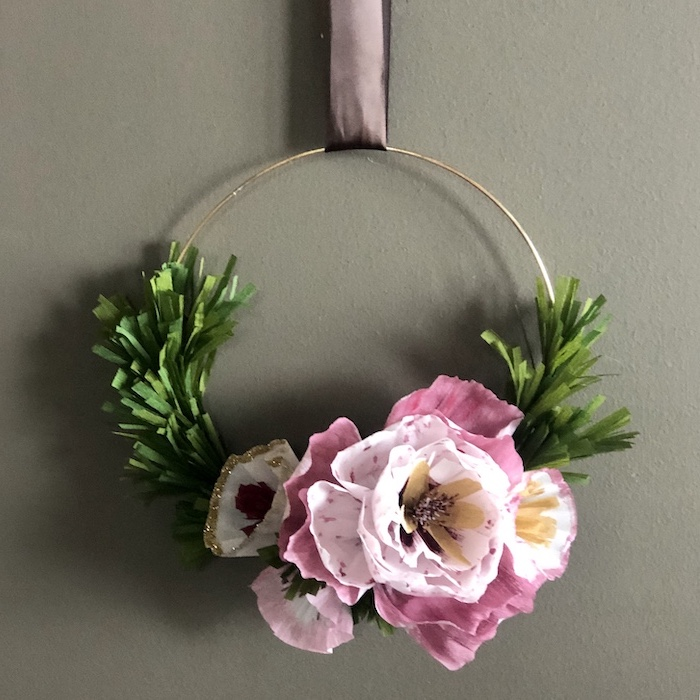 golden ring held by a satin bow, diy tissue paper flowers, wreath made with pink paper flowers and leaves