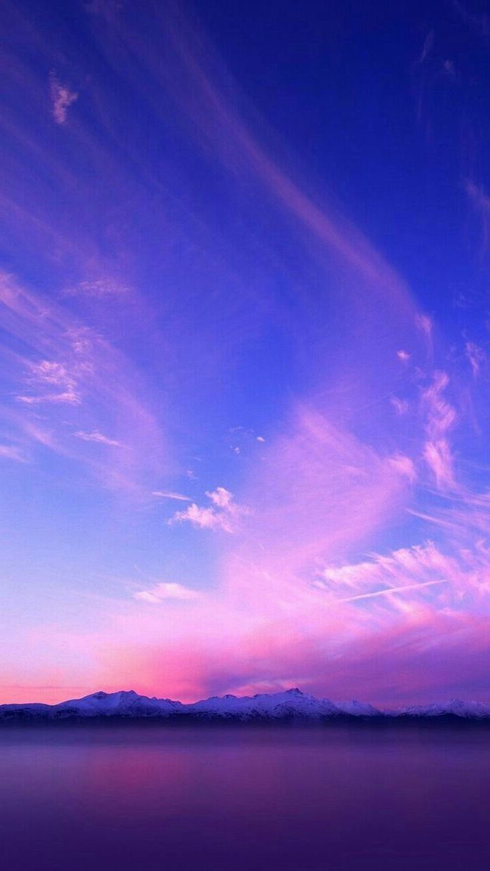 snowy mountain landscape, glass like like at the forefront, aesthetic lockscreen, blue sky with purple pink clouds
