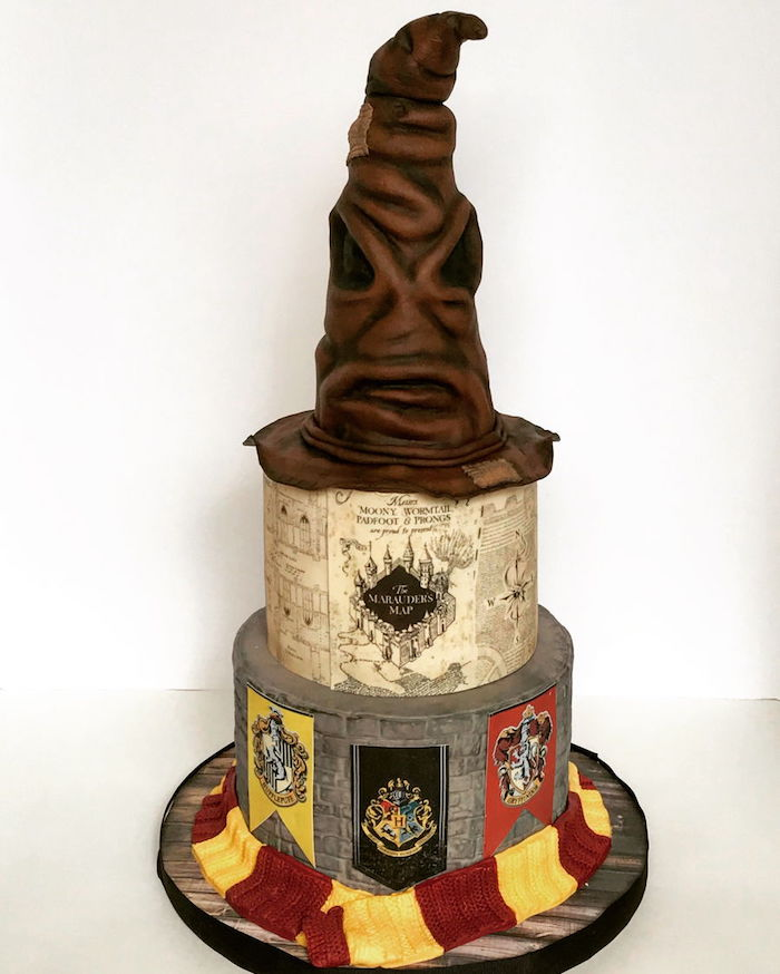 three tier cake, easy harry potter cake, marauder's map on middle tier, sorting hat top tier, gryffindor scarf around it