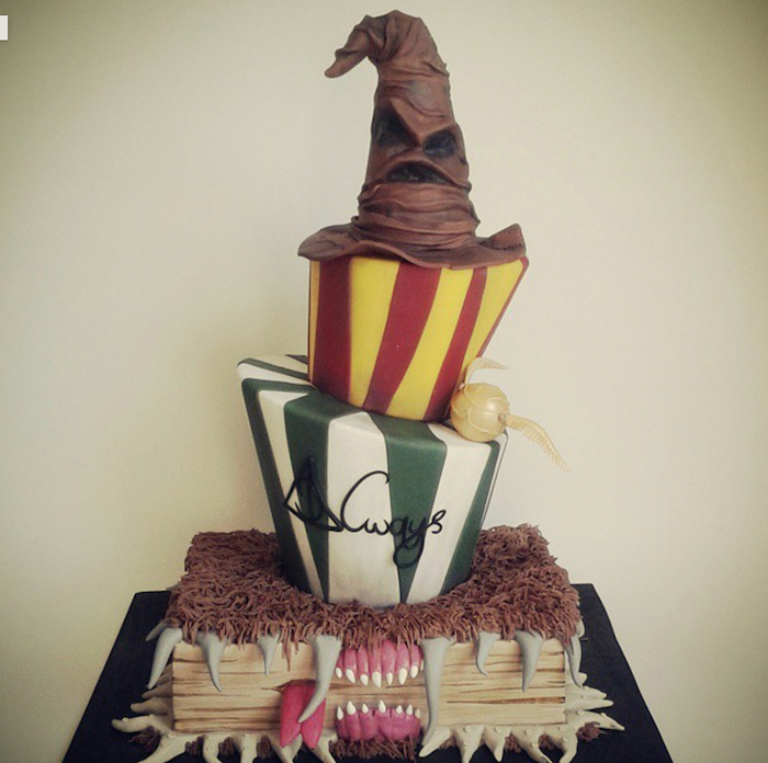 the monster books of monsters bottom layer, slytherin and gryffindor layers, sorting hat on top, easy harry potter cake