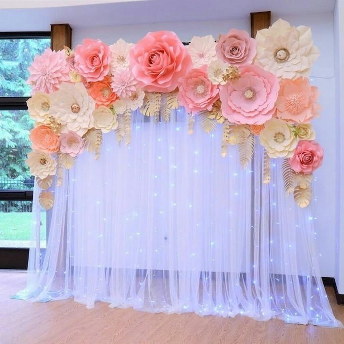 giant paper flower template, white tulle with fairy lights, large paper flowers on top, different shapes and sizes