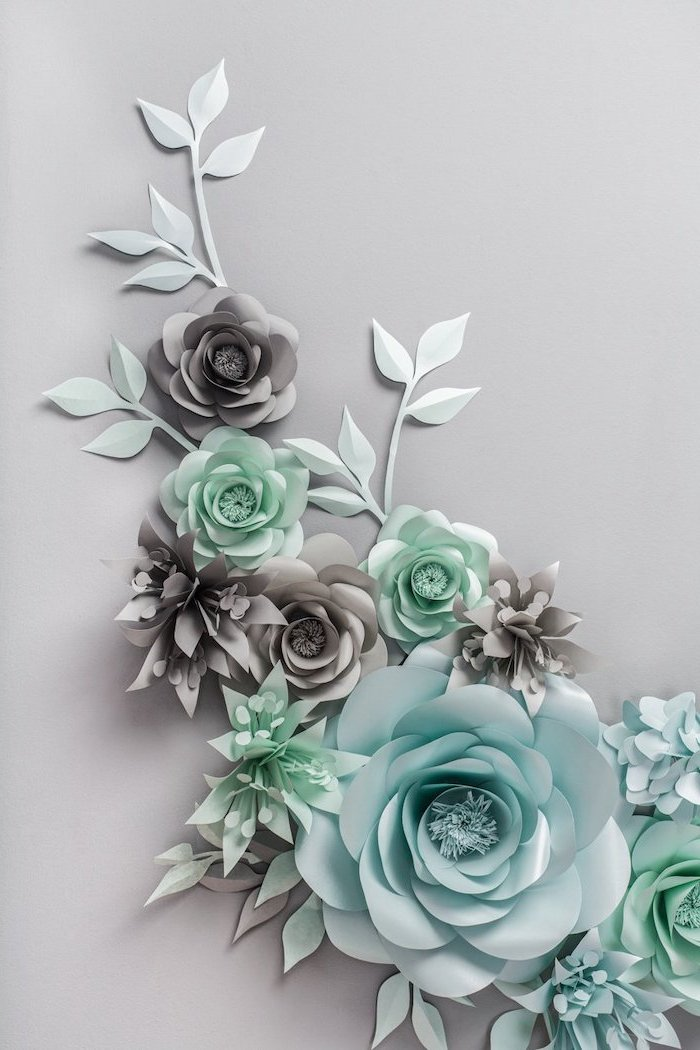 turquoise and grey paper flowers, different shapes and sizes, giant paper flower template, arranged on grey surface