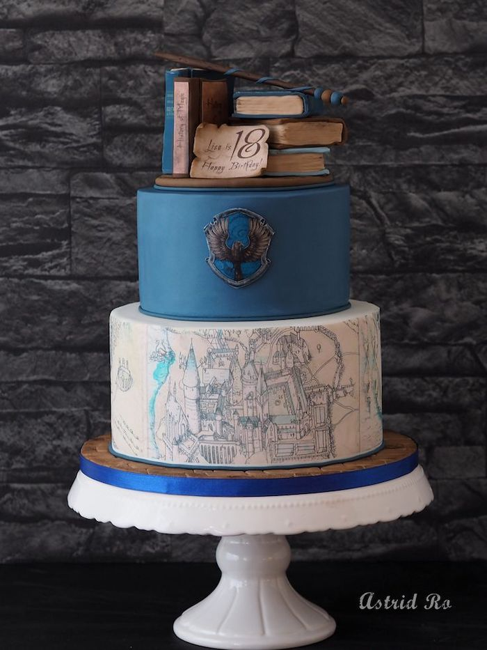 two tier ravenclaw cake, harry potter birthday cake hagrid, made with blue and white fondant, books and wand toppers