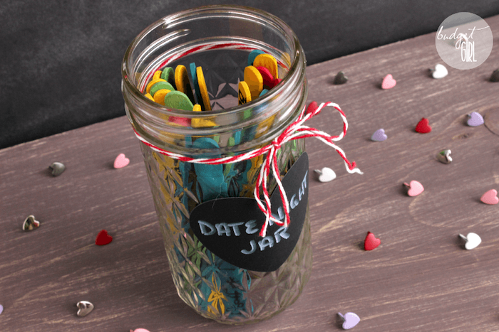 mason jar filled with date ideas, written on popsicle sticks, valentines day gifts, date night jar, placed on wooden surface