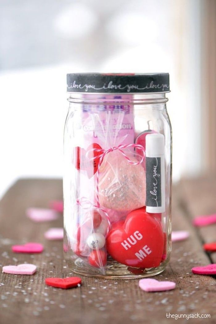 mason jar filled with different things, placed on wooden surface, valentines day gifts, conversation hearts and lip balm