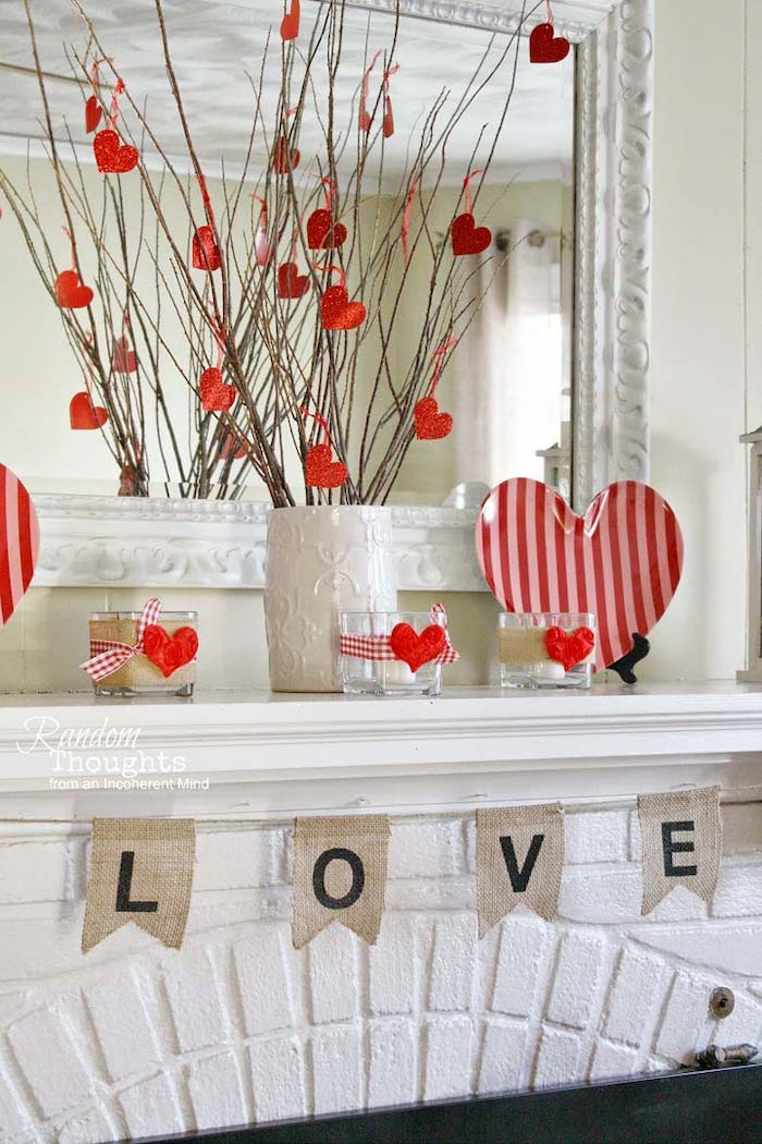 white vase filled with twigs, decorated with red hearts, valentines home decor, love banner over mantel, heart shaped plate