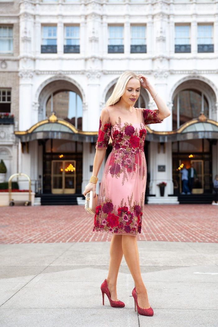 blonde woman wearing pink and red floral dress, valentines day outfit girl, walking on sidewalk, with red heels