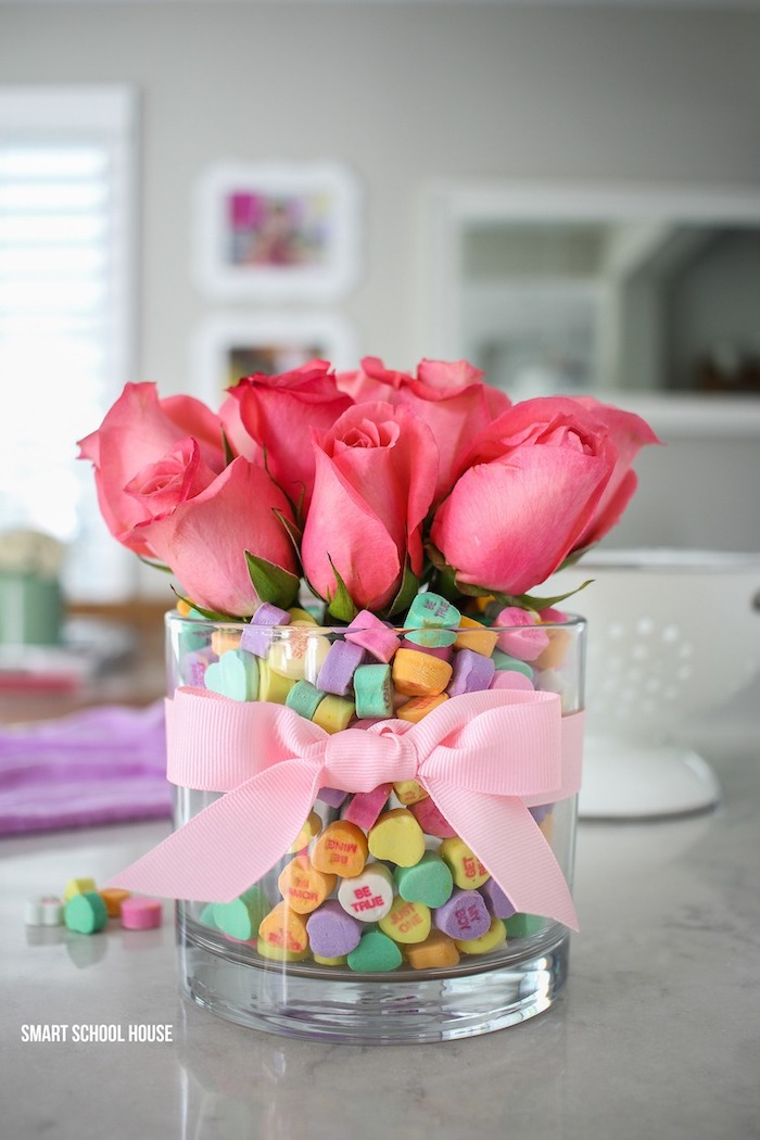 vase filled with conversation hearts, valentines day gifts for her, pink roses inside, wrapped with pink bow