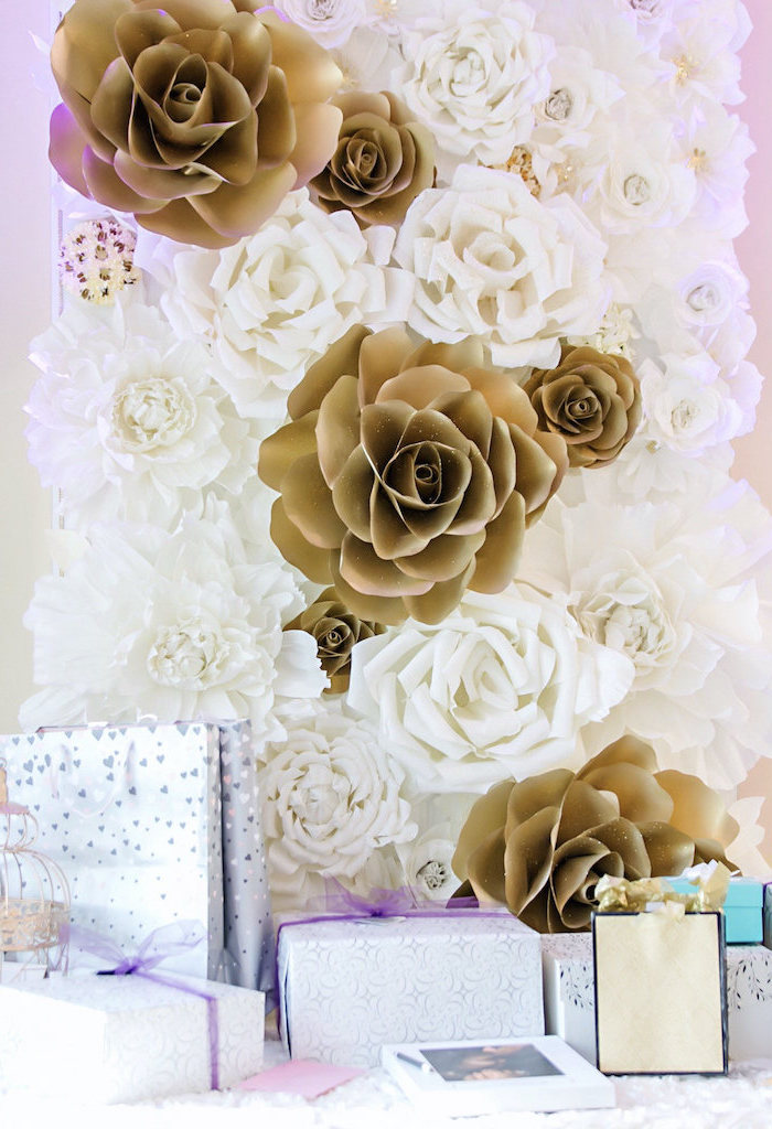 white and gold paper flowers, arranged as backdrop for table full of presents, giant paper flower template