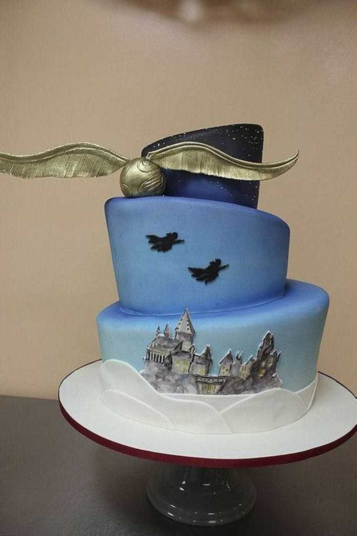three tier cake, made with blue fondant, diy harry potter cake, golden snitch on the side, hogwarts drawn on bottom tier