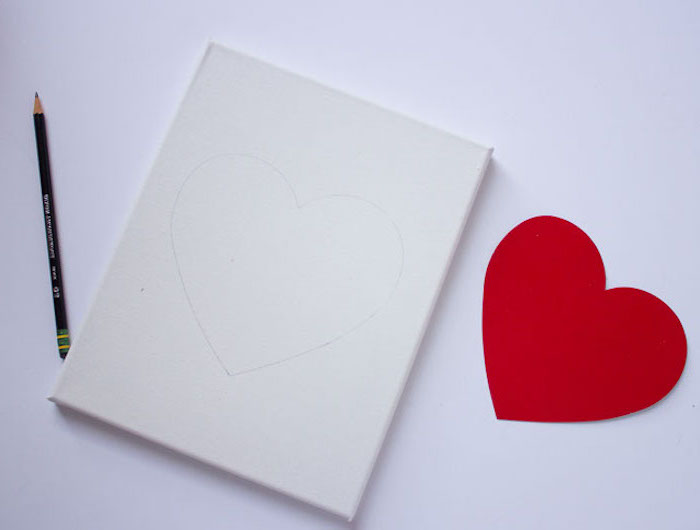 white canvas, red heart shape traced on it with pencil, placed on white surface, step by step diy tutorial, valentine decorations