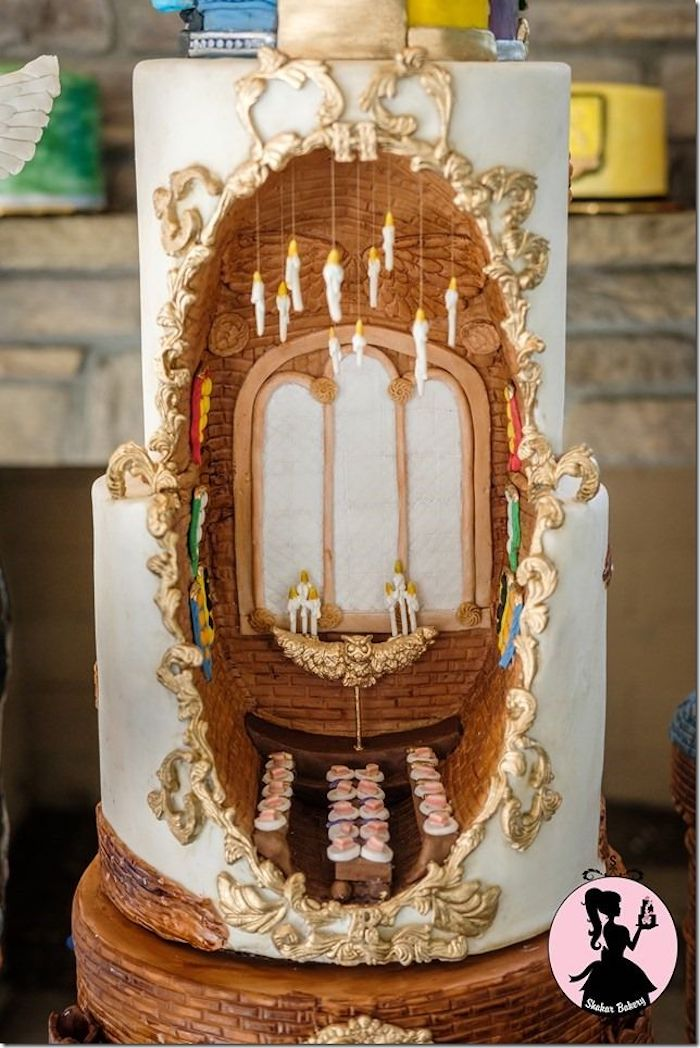 two tier cake, inside taken out, the great hall portrayed in the middle, diy harry potter cake, candles hanging made of fondant