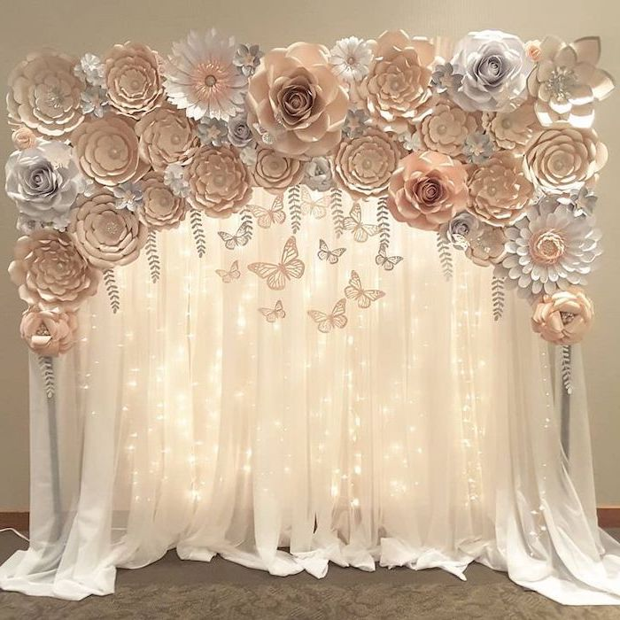 white tulle with fairy lights, rose gold and white paper flowers on top, giant paper flower template, different shapes and sizes