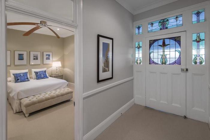 hallway and bedroom with white walls, white door decorated with stained glass, custom stained glass