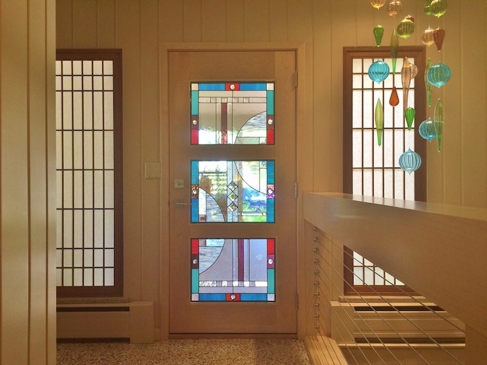 hallway with white walls, front door with colored glass, two windows on both sides, custom stained glass, stained glass chandelier