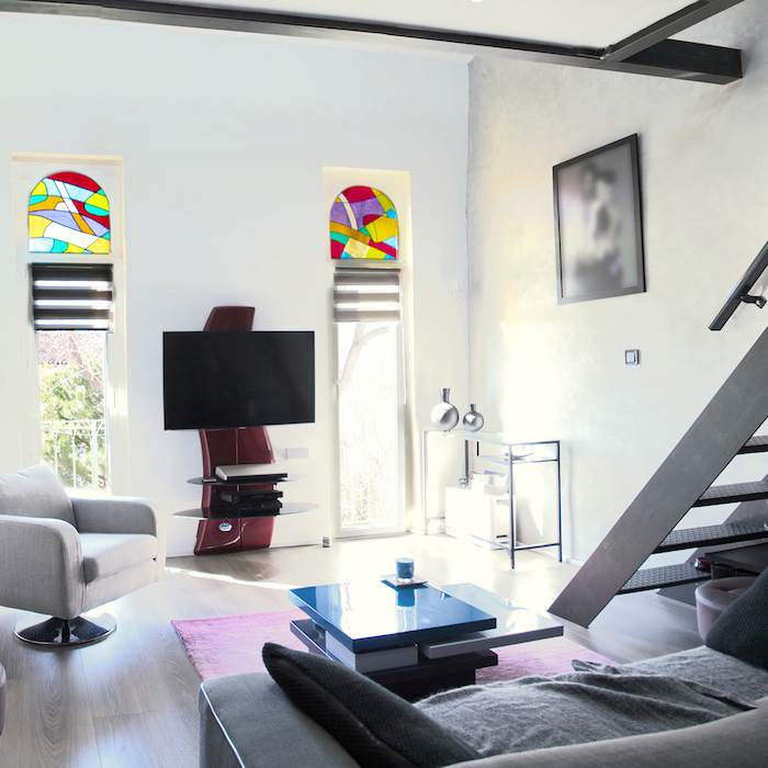how to make stained glass windows, two storey flat with staircase inside, two narrow and tall windows, grey sofa and armchair