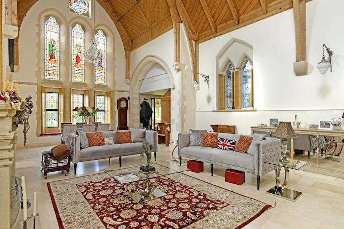 vintage style living room, cathedral ceiling and windows, how to make stained glass windows, grey velvet sofas