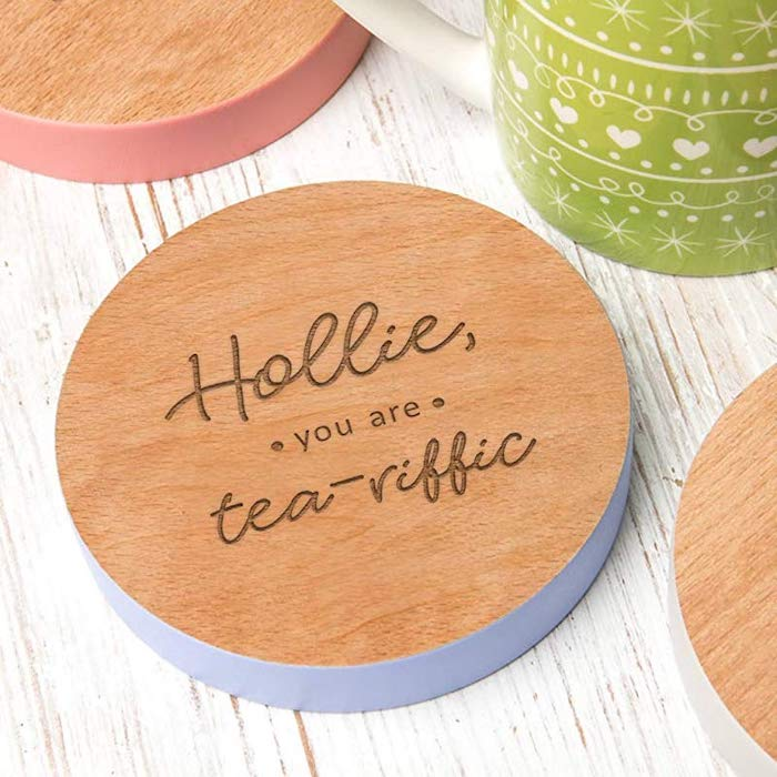 personalised wooden coasters, hollie you are tea riffic, valentine gifts for wife, placed on white wooden surface