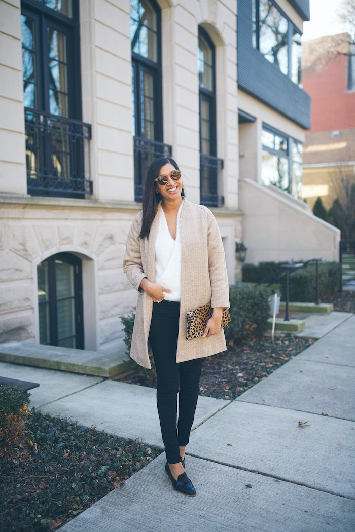 cute valentines day outfits, woman standing on sidewalk, wearing black pants and white blouse, nude cardigan