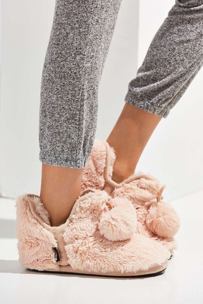 woman wearing grey joggers, blush cozy slippers, valentine gifts for wife, white background