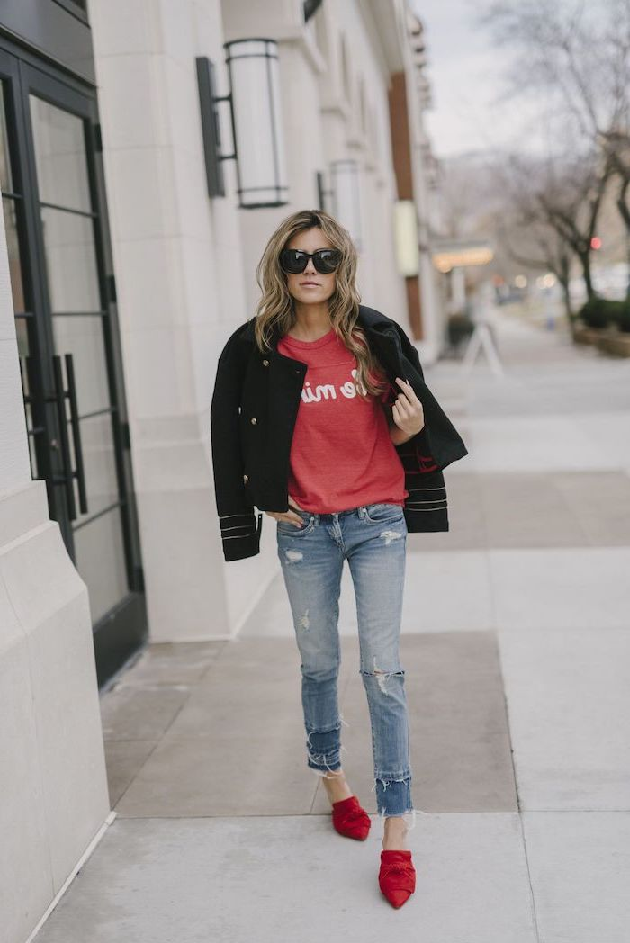woman wearing jeans and pink blouse, black leather jacket, cute valentines day outfits, red velvet shoes