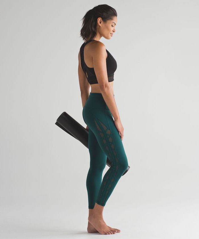 woman wearing sports bra, green yoga pants, carrying yoga mat, valentine gifts for wife, white background