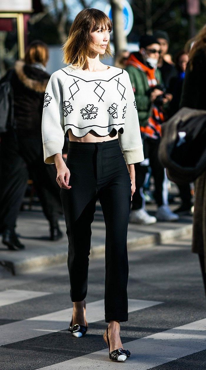 woman walking down the street, wearing white crop top, black pants, what to wear on valentine's day