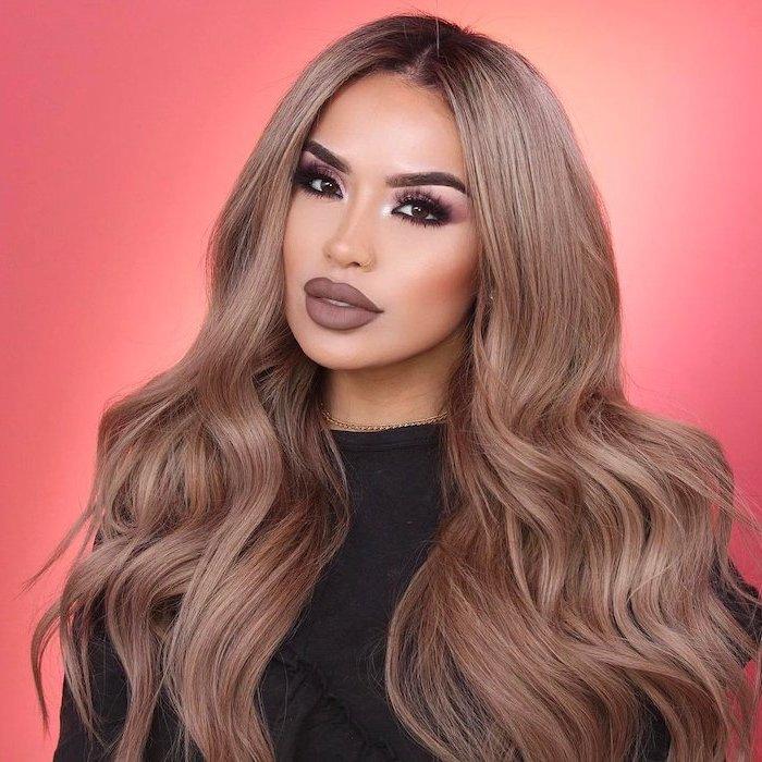 woman with long dark blonde wavy hair, best eyeshadow for blue eyes, pink eyeshadow colors, dark brown lipstick