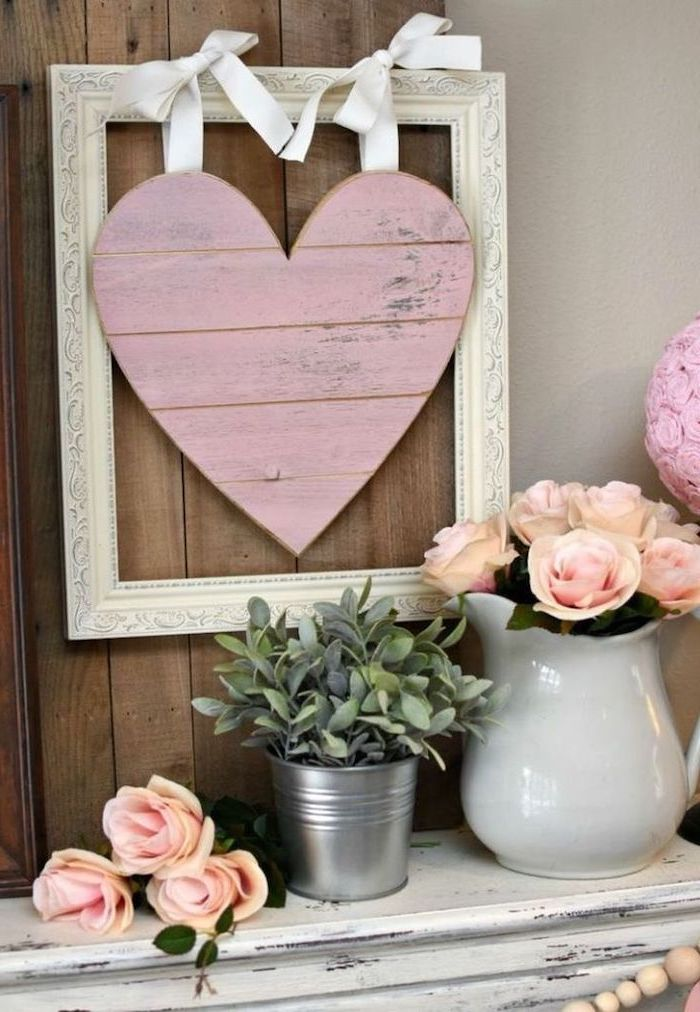 valentine day table decorations, vintage-wooden-frame, pink wooden heart in the middle, bouquets of pink roses