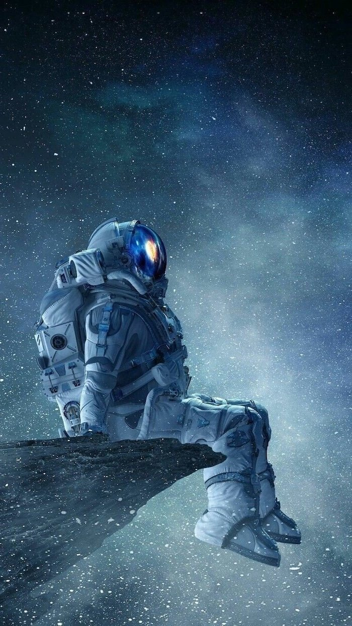 astronaut in a suit, sitting on the edge of a rock, galaxy wallpaper, starring into space, sky filled with stars