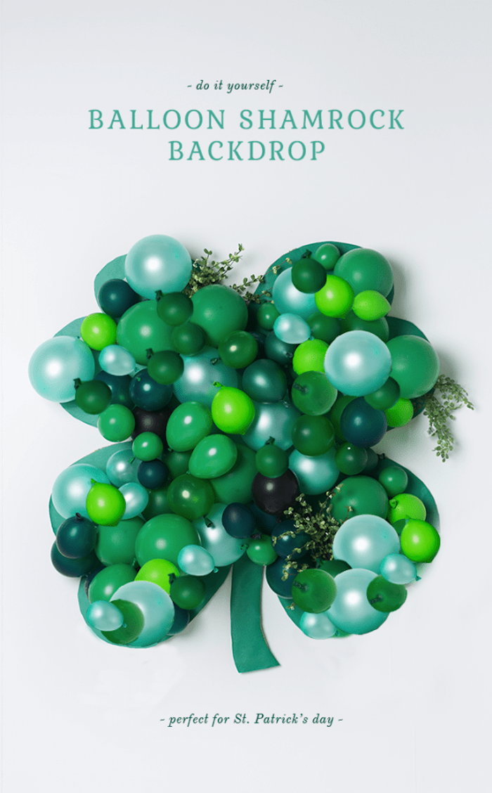 step by step diy tutorial, balloon shamrock backdrop, hanging on white wall, happy st patrick's day