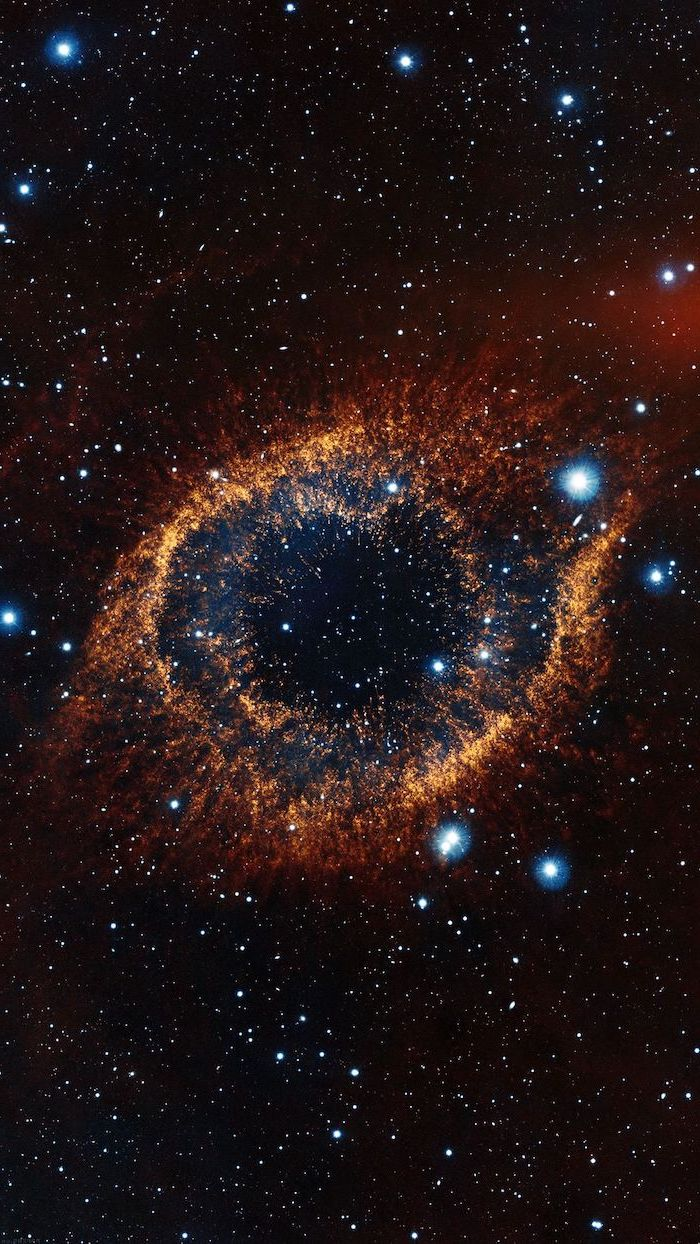 sky filled with stars, galaxy wallpaper, black sky with eye shaped galaxy in the middle, orange blue and red colors