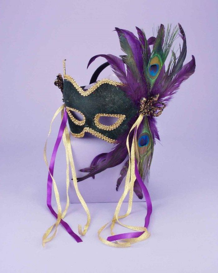 black mask with gold decorations, masquerade masks for women, decorated with purple and green peacock feathers