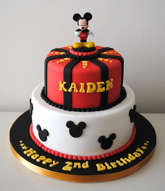 two tier cake, covered with red white and black fondant, mickey mouse cake, mickey cake topper